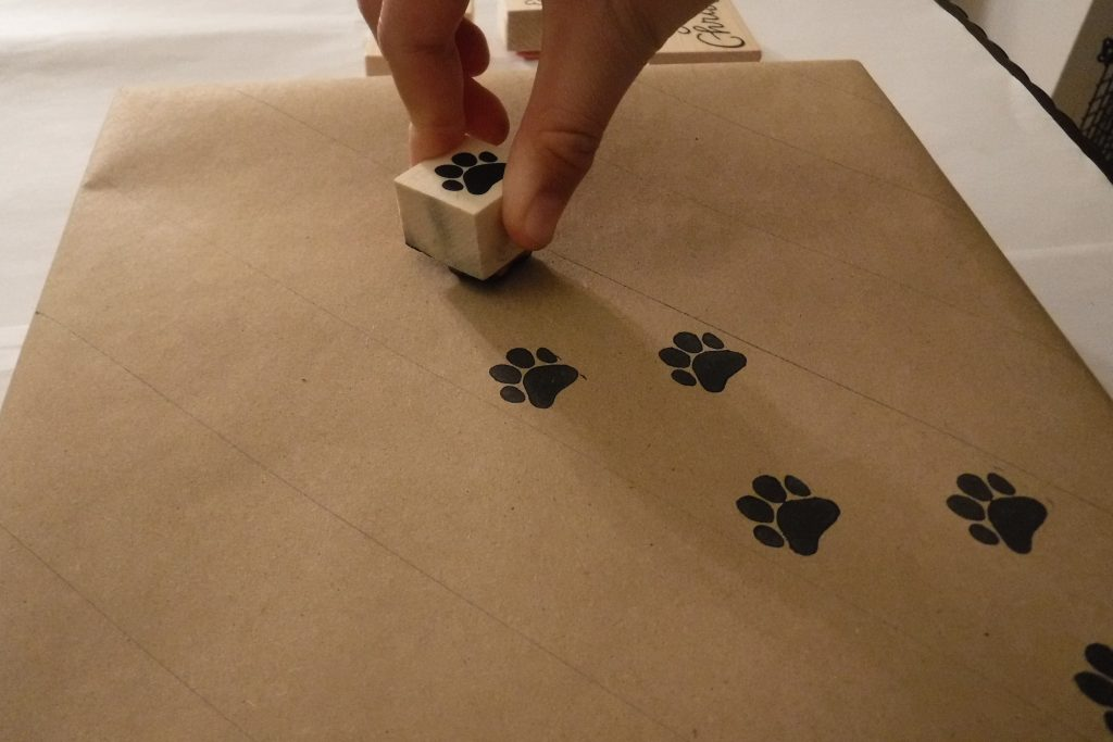 Stamped paw prints on gift wrap