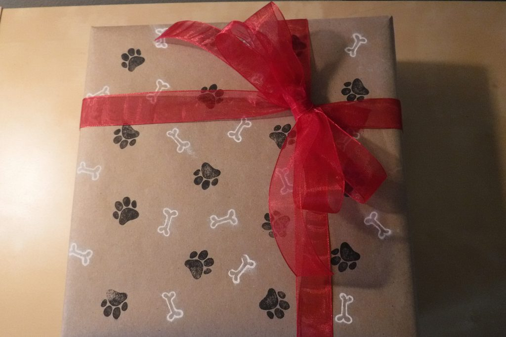 DIY Dog Gift Wrap Paw and Bone Design with red ribbon
